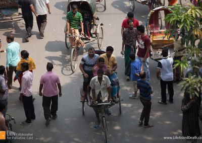 Pedal powered patient transport - tricycle rickshaws provide economical and convenient transport in Dhaka, Bangladesh.
